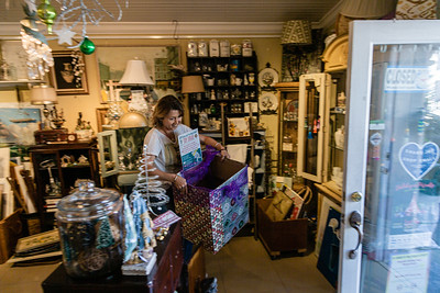 Inge Skelly, owner of Stone Button Studio in Northwood Village brings her displays outdoors as she opens her shop on Northwood Road, Saturday, November 28, 2020. A Northwood Village resident, Skelly had to close her shop for 79 days due to the COVID-19 pandemic and has been open since June 1, 2020. Skelly has owned her shop for five and a half years and is also the Vice President of of the Northwood Village Merchant Association. (JOSEPH FORZANO / THE PALM BEACH POST)
