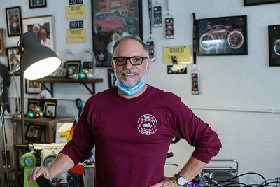 Portrait of Peter Kisgen, owner of Old Metal Classics Café and More in Northwood Village, Saturday, November 28, 2020. Kisgen has owned the motorcycle themed cafe for 3 years. (JOSEPH FORZANO / THE PALM BEACH POST)