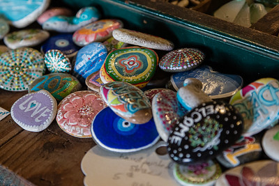 Some of the painted stones for sale that give Stone Button Studios in Northwood Village its name, Saturday, November, 28, 2020. (JOSEPH FORZANO / THE PALM BEACH POST)