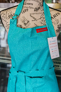 Carol Gallant, owner of Bistro Bistro in Northwood Village is starting a new line of hand crafted kitchen wear and other accessories, called La Coquine. One of Gallant's hand crafted apron on display at Bistro Bistro, Saturday, November 28, 2020. (JOSEPH FORZANO / THE PALM BEACH POST)
