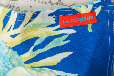 A detail of one of the aprons hand crafted by Carol Gallant, owner of Bistro Bistro in Northwood Village, Saturday, November 28, 2020. Gallant is creating kitchen wear and other accessories, under the name  La Coquine. (JOSEPH FORZANO / THE PALM BEACH POST)