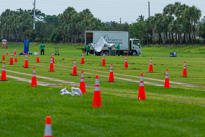 Workers take down tents at the COVID-19 testing site at the FITTEAM Ballpark of the Palm Beaches, in West Palm Beach, Tuesday, April 26, 2020. The site was closed today because of flooding from the storms on Memorial Day. [JOSEPH FORZANO/palmbeachpost.com]