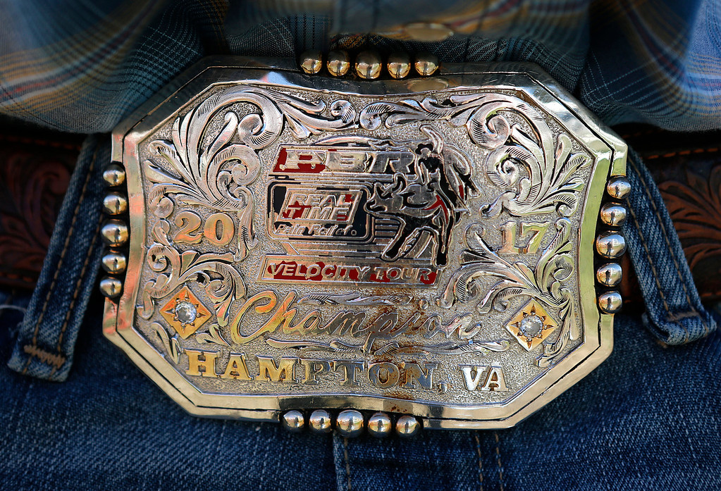 . Brandon Davis wears paint chipped belt buckle he won at the Professional Bull Riding event at Hampton, Virginia earlier in 2017 at the Salinas Rodeo grounds on Wednesday July 19, 2017. (David Royal/Herald Correspondent)