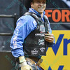 Rider J.W. HARRIS puts a smile on his face after completing a successful ride during the second round at the Professional Bull Riders Built Ford Tough Series presented by Cooper Tires at the Scottrade Center in St. Louis, Missouri