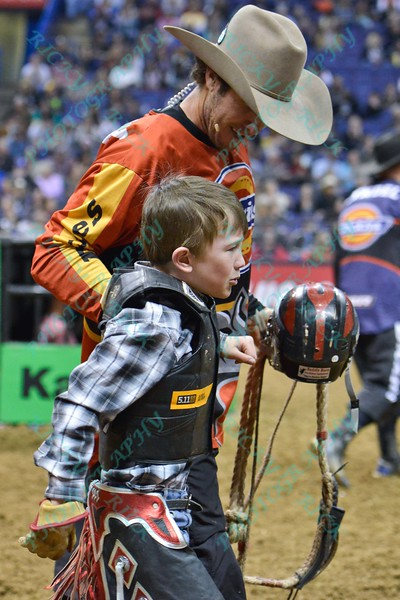 junior bull rider LOGAN WHITE gets help from Bullfighter SHORTY GORHAM (red) after falling hard during the final round at the Professional Bull Riders Built Ford Tough Series, Bass Pro Chute Out presented by Cooper Tires at the Scottrade Center in St. Louis, Missouri