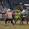 Bullfighter FRANK NEWSOM (orange), Bullfighter SHORTY GORHAM (red) and Bullfighter Lyndel Runyan (blue) try to distract bull LOCOMOTION so Rider L.J. JENKINS can get off after a successful ride during the first round at the Professional Bull Riders Built Ford Tough Series, Bass Pro Chute Out presented by Cooper Tires at the Scottrade Center in St. Louis, Missouri