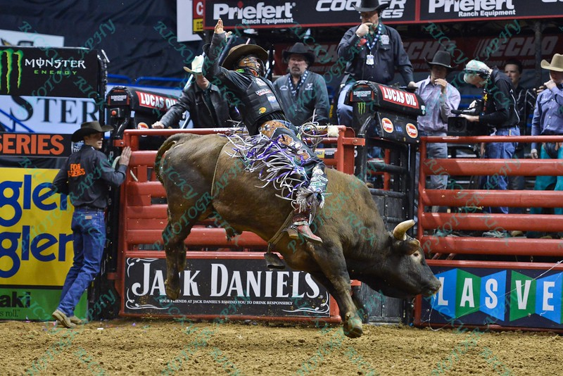 Rider CODY NANCE  on bull LONGMIRE during the third round at the Professional Bull Riders Built Ford Tough Series, Bass Pro Chute Out presented by Cooper Tires at the Scottrade Center in St. Louis, Missouri