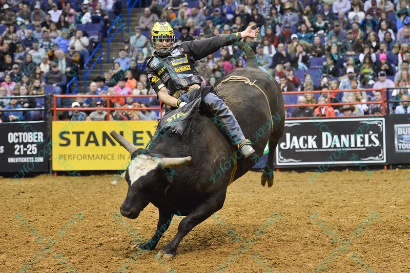 Rider SILVANO ALVES  tries to complete his ride on bull WICKED during the second round at the Professional Bull Riders Built Ford Tough Series presented by Cooper Tires at the Scottrade Center in St. Louis, Missouri