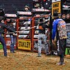 Workers get ready to pull open the chute during the first round at the Professional Bull Riders Built Ford Tough Series, Bass Pro Chute Out presented by Cooper Tires at the Scottrade Center in St. Louis, Missouri