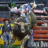 Rider RENATO NUNES  leans way back to keep his balance on bull DIESEL during the championship round at the Professional Bull Riders Built Ford Tough Series, Bass Pro Chute Out presented by Cooper Tires at the Scottrade Center in St. Louis, Missouri