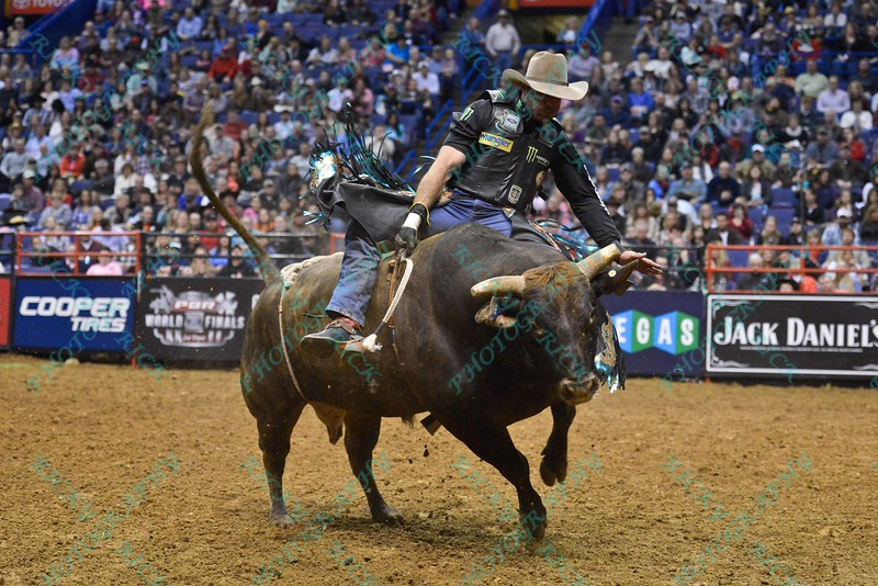 Rider GUILHERME MARCHI on bull LANE'S MAGIC TRAIN during the second round at the Professional Bull Riders Built Ford Tough Series, Bass Pro Chute Out presented by Cooper Tires at the Scottrade Center in St. Louis, Missouri