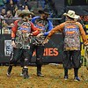Bullfighter FRANK NEWSOM (orange), Bullfighter SHORTY GORHAM (red) and Bullfighter Lyndel Runyan (blue) congratulate each other on a job well done during the first round at the Professional Bull Riders Built Ford Tough Series, Chute Out presented by Cooper Tires at the Scottrade Center in St. Louis, Missouri