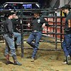 Workers for the PBR takes some time to relax and talk before the first round at the Professional Bull Riders Built Ford Tough Series, Chute Out presented by Cooper Tires at the Scottrade Center in St. Louis, Missouri