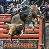 bull FIRE ROCK jumps high in the air to try and buck bull HOU'S BACK during the championship round at the Professional Bull Riders Built Ford Tough Series, Bass Pro Chute Out presented by Cooper Tires at the Scottrade Center in St. Louis, Missouri