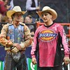 Rider DAVE MASON talks with Bullfighter FRANK NEWSOM (orange)during the second round at the Professional Bull Riders Built Ford Tough Series presented by Cooper Tires at the Scottrade Center in St. Louis, Missouri