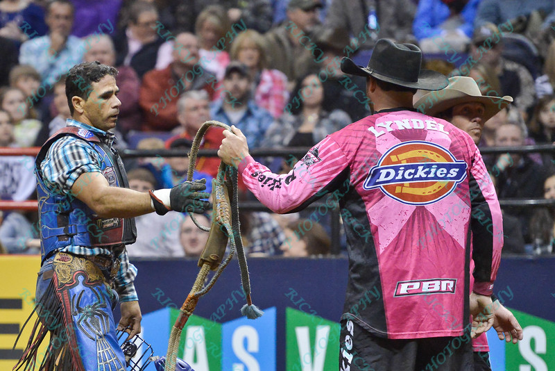 Rider ROBSON ARAGAO gets his ropes from Bullfighter Lyndel Runyan (blue) during the second round at the Professional Bull Riders Built Ford Tough Series presented by Cooper Tires at the Scottrade Center in St. Louis, Missouri