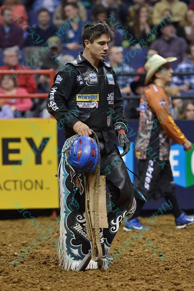 Rider MIKE LEE during the first round at the Professional Bull Riders Built Ford Tough Series, Bass Pro Chute Out presented by Cooper Tires at the Scottrade Center in St. Louis, Missouri