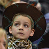 A young fan watches the replay during the first round at the Professional Bull Riders Built Ford Tough Series, Chute Out presented by Cooper Tires at the Scottrade Center in St. Louis, Missouri