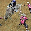 Bullfighter FRANK NEWSOM (orange), Bullfighter Lyndel Runyan (blue) and Bullfighter SHORTY GORHAM (red) try to distract bull REMEMBER WHEN so Rider MIKE LEE can dismount during the second round at the Professional Bull Riders Built Ford Tough Series, Bass Pro Chute Out presented by Cooper Tires at the Scottrade Center in St. Louis, Missouri