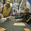 Rider SILVANO ALVES shakes hands with a young fan as he is signing autographs during the first round at the Professional Bull Riders Built Ford Tough Series, Chute Out presented by Cooper Tires at the Scottrade Center in St. Louis, Missouri