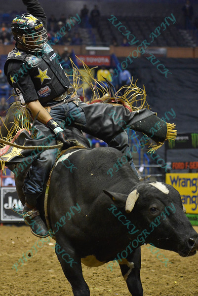 Rider VALDIRON DE OLIVEIRA completes a successful ride on bull COWTOWN ROCK during the first round at the Professional Bull Riders Built Ford Tough Series, Chute Out presented by Cooper Tires at the Scottrade Center in St. Louis, Missouri