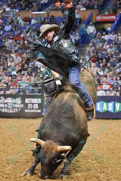 Rider GUILHERME MARCHI starts to lose control on bull LANE'S MAGIC TRAIN during the second round at the Professional Bull Riders Built Ford Tough Series presented by Cooper Tires at the Scottrade Center in St. Louis, Missouri