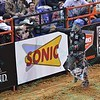 Rider MIKE LEE takes a victory lap and high fives with fans after a successful ride during the second round at the Professional Bull Riders Built Ford Tough Series presented by Cooper Tires at the Scottrade Center in St. Louis, Missouri