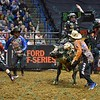 Bullfighter FRANK NEWSOM (orange) tries to distract bull LOCOMOTION so Rider L.J. JENKINS can get loose after his successful ride during the first round at the Professional Bull Riders Built Ford Tough Series, Chute Out presented by Cooper Tires at the Scottrade Center in St. Louis, Missouri