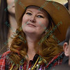 A fan combines the cowgirl spirit and Mardi Gras which is happening at the same time during the first round at the Professional Bull Riders Built Ford Tough Series, Chute Out presented by Cooper Tires at the Scottrade Center in St. Louis, Missouri