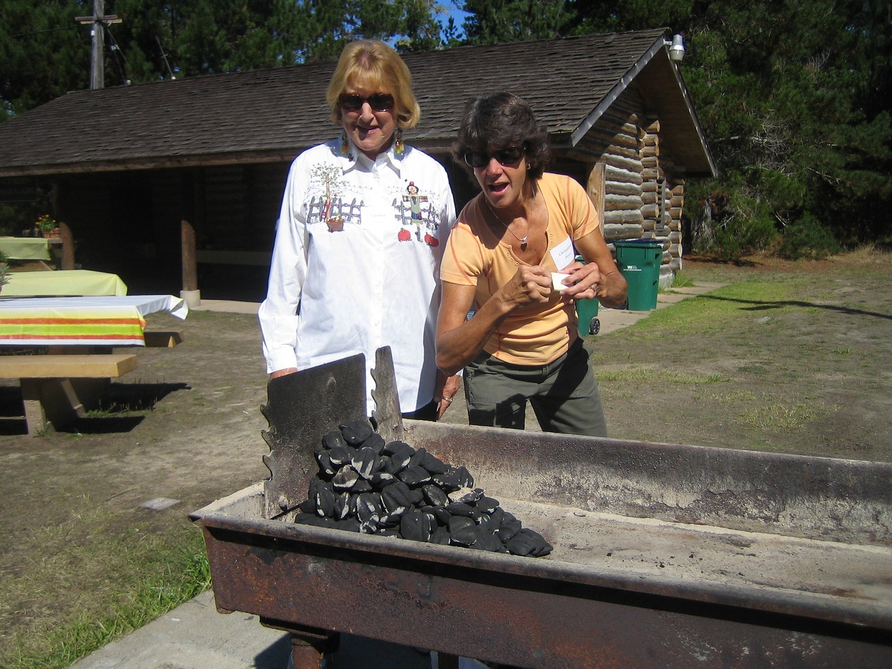 Okay now, Jeannie Young and Christine Olson are prepared to start the fire.