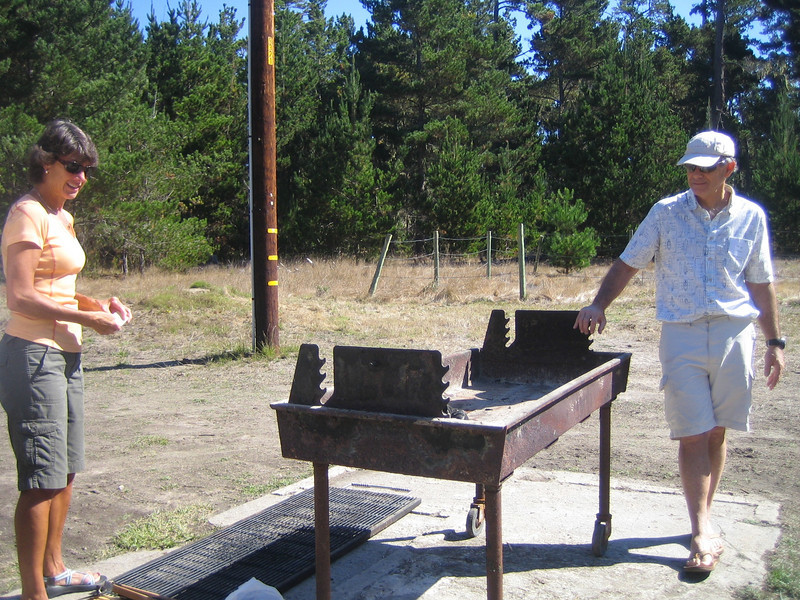 Okay, everyone, there is a lot of fluid on this charcoal. Step back! Christine and Dave prepare the barbecue.