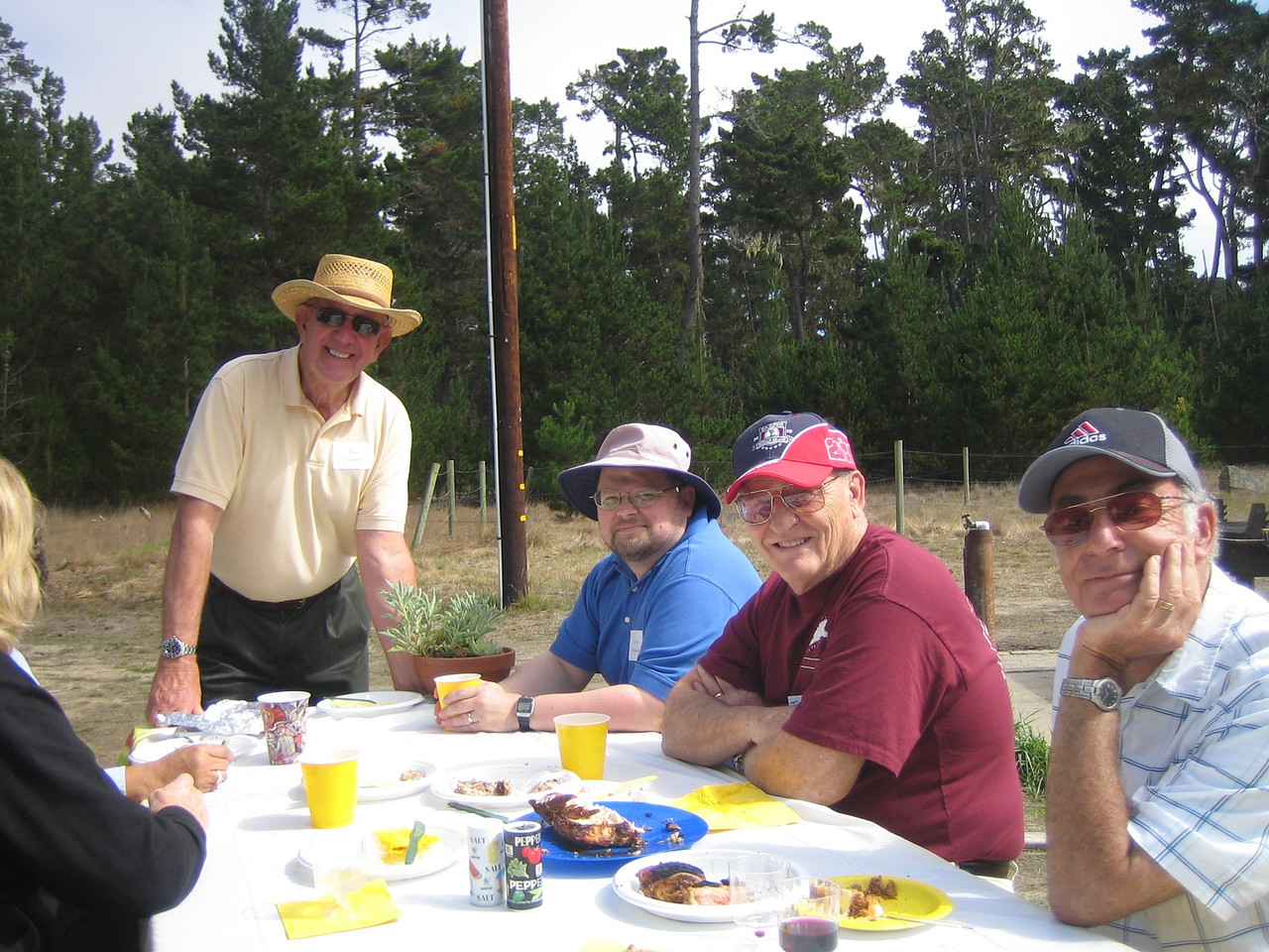 Sharing a meal are Don Eastman, Dirk Barthelow, Terry Alfriend, and Michael Young.