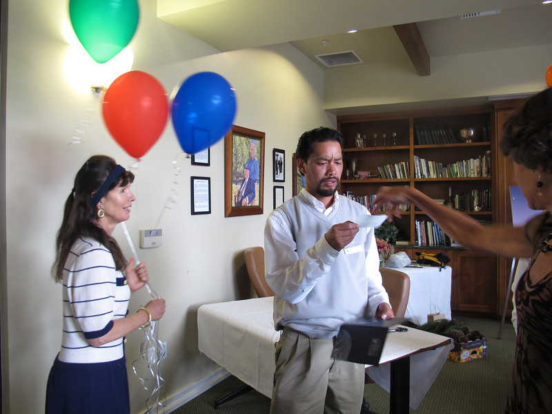 Gail looks on as Christine pays Anthony for the great catering job from Poppy Hills' Porter's Cafe.