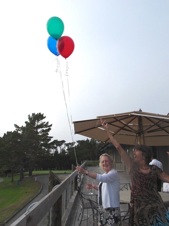 At the end of the party, a symbolic balloon release of green, red, and blue--a party for the trails.