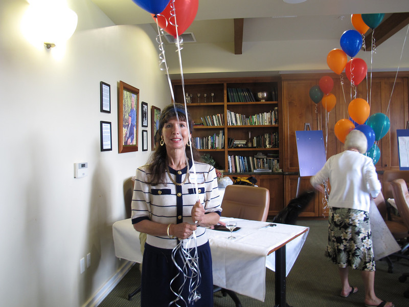 Gail gathers the balloons at the end of the party