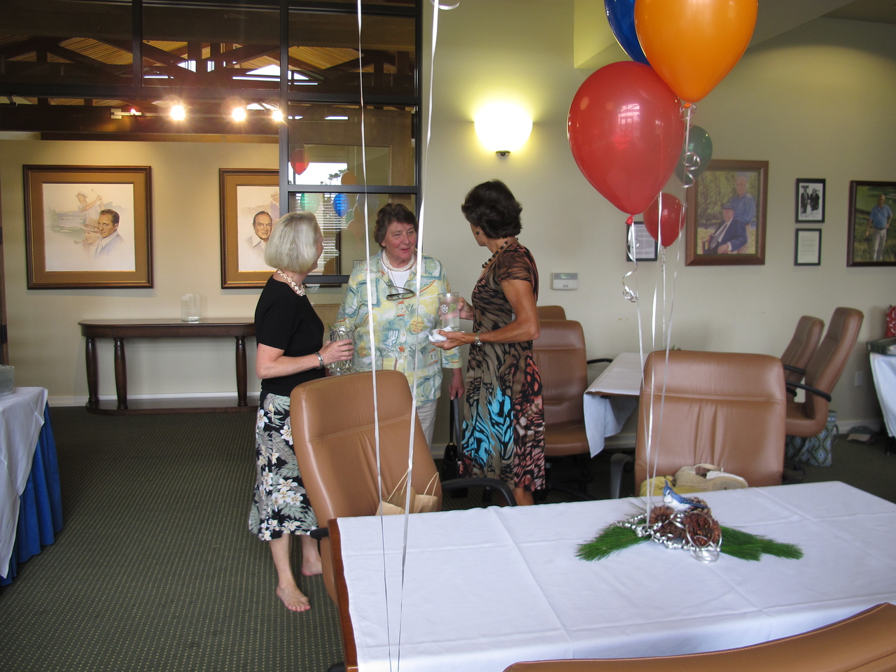 Kim Caneer, Marie-France de Sibert, and Christine Olson, having finished decorating, take a moment to chat before the guests arrive.