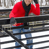 PCHY LEANING ON BRIDGE IN SNOW
