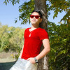 PCHY MOORE LEANING ON TREE RED SHIRT AND SUNGLASSES