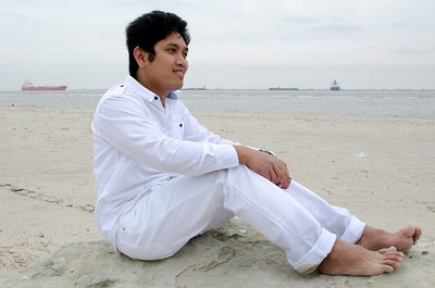 PCHY MOORE SITTING ON BEACH