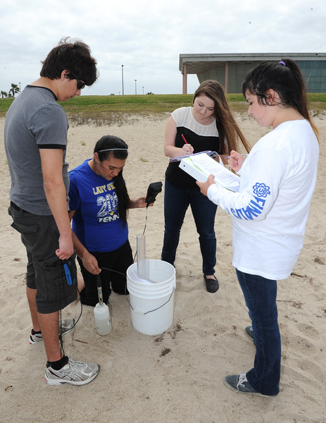 Environmental Science students test water samples at the University's beach