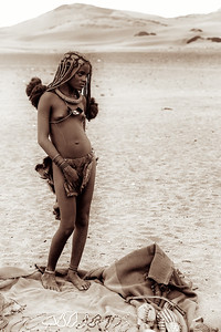 Himba women and children in the desert of Northern Mongolia near the Angolan border