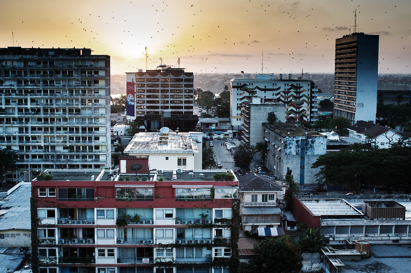 Sunset over Abidjan, with bats returning to their roosting sites (the tall trees of the Plateau)