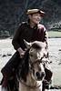 A passing horseman - eastern Tibet, China