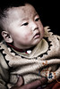 Baby in traditional knitwear - eastern Tibet