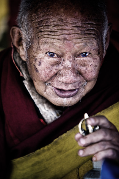 Tibetan priest during a blessing ceremony - eastern Tibet