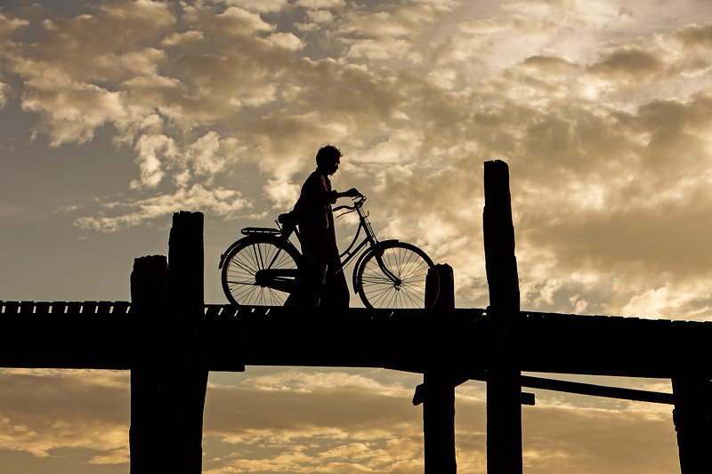 A lone cyclist on U Bein bridge - Mandalay, Myanmar