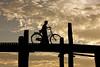 A lone cyclist on U Bein bridge - Mandalay, Myanmar