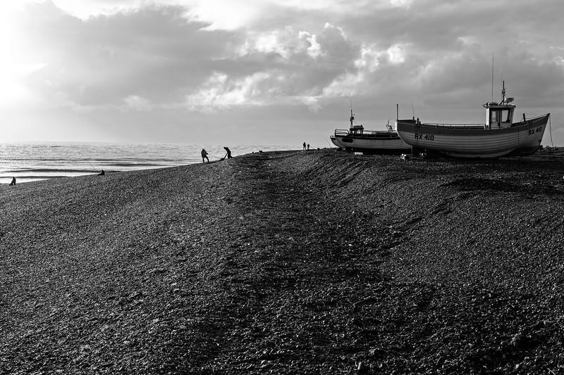 Fisherman at work on Dungeness' shingle beach, U.K