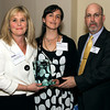 Larry Burns, vice president of First Niagara Finaincial Group, presents the Humanitarian of the Year Award to Sheila Branyan, left, and Rachel Haynes Coombs,  the daughters of the recipient, the late Virginia Coombs, director of the Visiting Nurse Association.<br />  Bb Raines 5/19/10