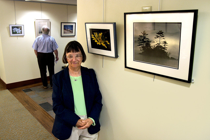 Eileen McDonnell with her photographs which are on display in the lobby of Foulkeways at Gwynedd.<br /> Bob Raines 9/29/10